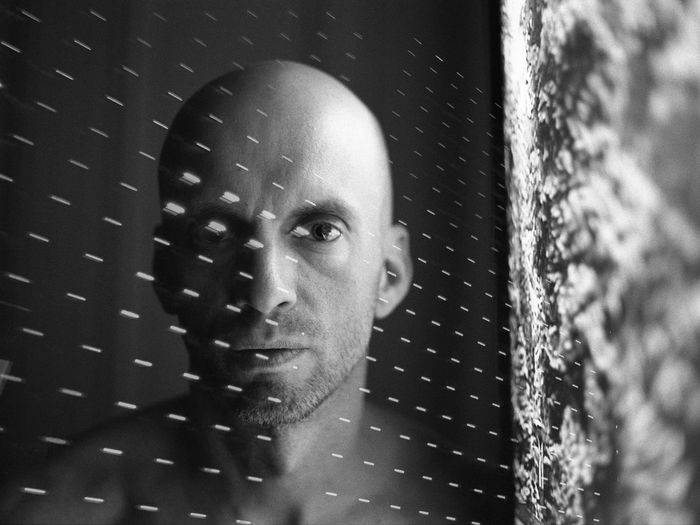Digital Composite Image Of Bald Man And Light