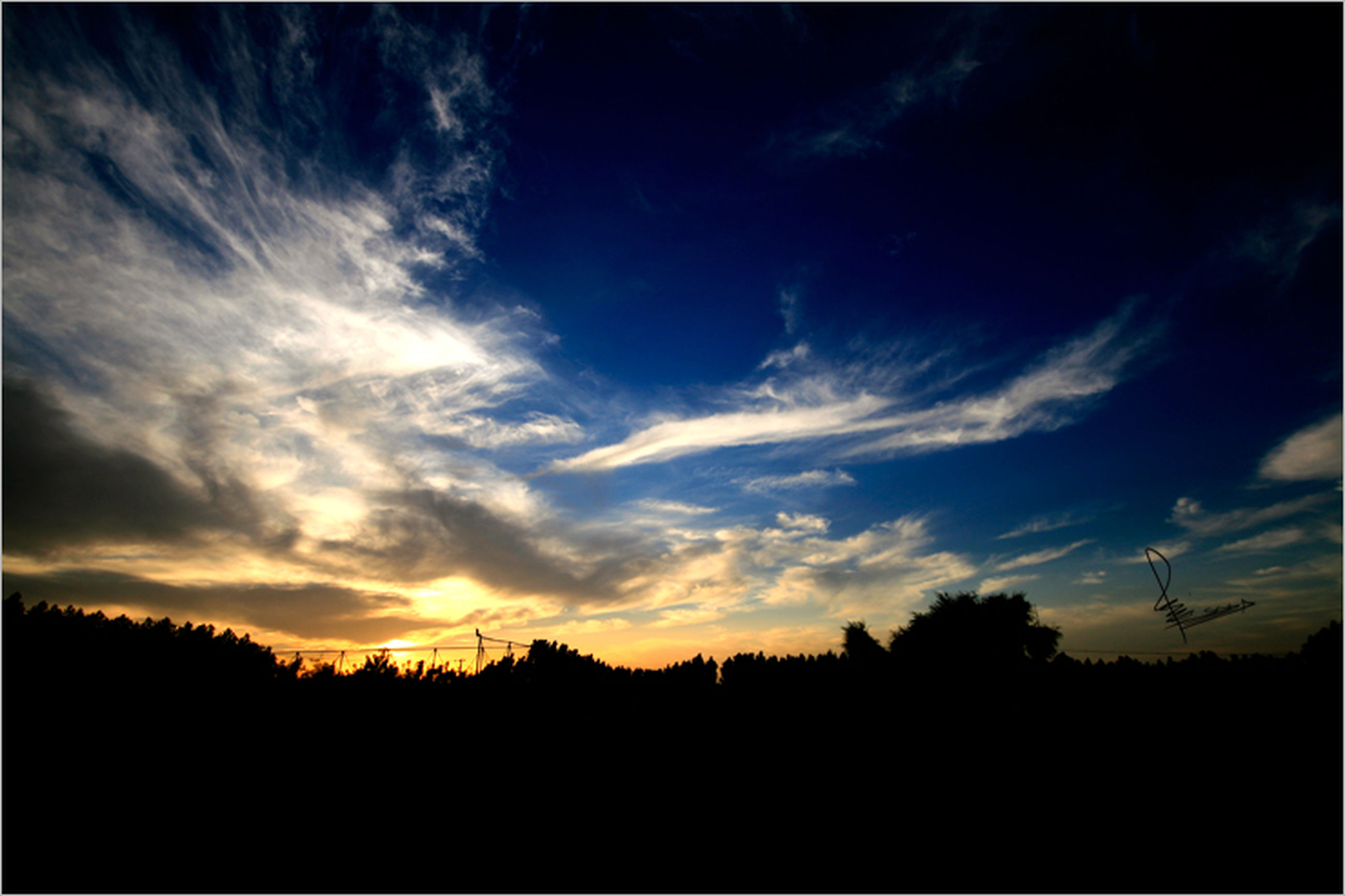 silhouette, sunset, tranquil scene, scenics, tranquility, sky, beauty in nature, tree, nature, cloud - sky, landscape, idyllic, dark, cloud, outline, outdoors, dramatic sky, non urban scene, non-urban scene, no people