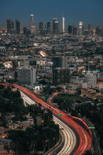 High angle view of illuminated downtown los angeles during sunset