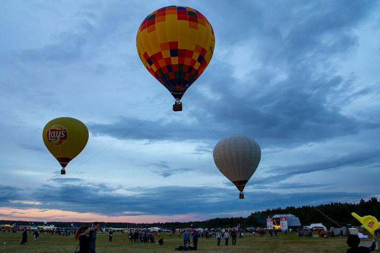 Hot air balloons flying against sky