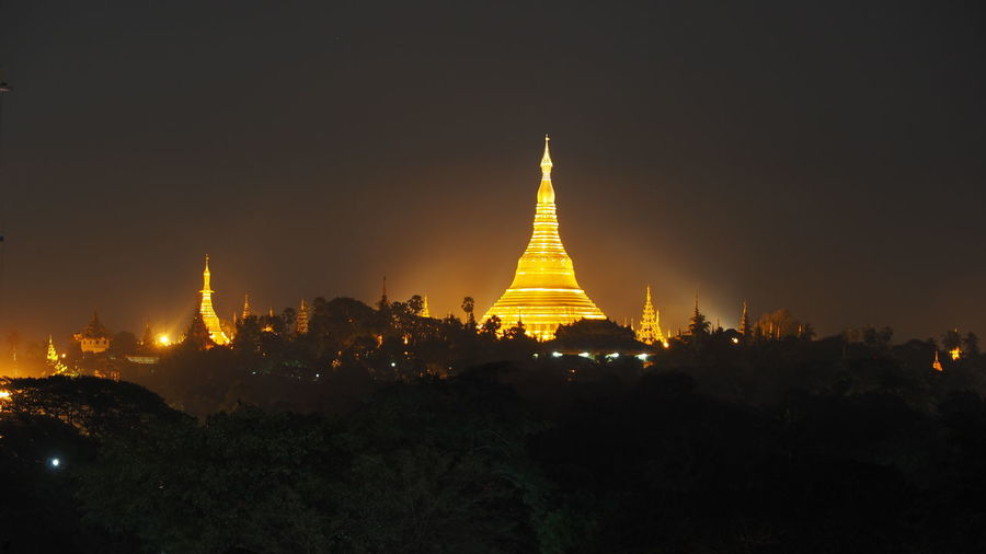 View of Shwedagon pagoa at night Architecture Built Structure Culture Cultures Dark Famous Place Illuminated International Landmark Night Orange Color Shwedagon Pagoda Yangoon Myanmar