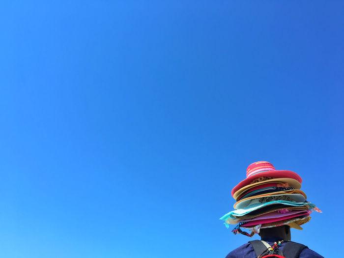 Low angle view of vendor against blue sky