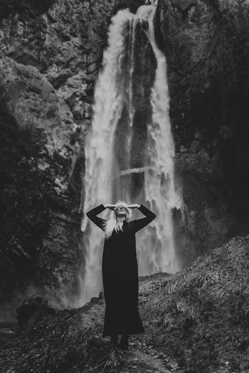 Girl standing on rock in forest