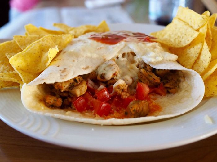 Close-up of burrito served in plate on table
