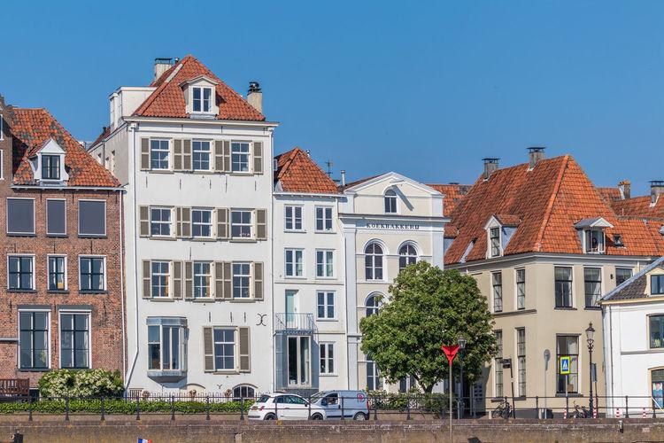 Buildings against blue sky in city