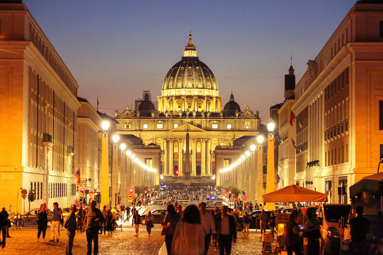 Crowd Visiting St Peter Basilica At Night