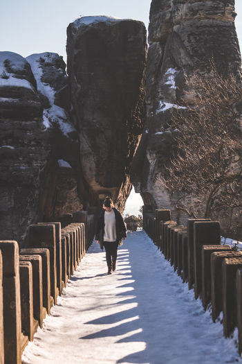 Architecture Built Structure Casual Clothing Day Direction Footpath Full Length Leisure Activity Lifestyles Nature One Person Outdoors Railing Real People Rear View Rock Saxon Switzerland Saxony Standing The Way Forward Walking Young Adult