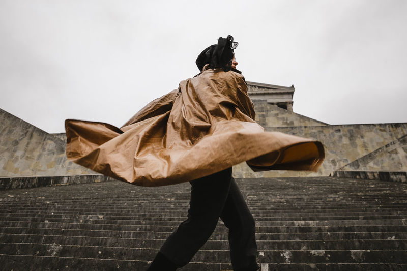 tornado One Person Architecture Sky Real People Day Built Structure Standing Wall Side View Wall - Building Feature Building Exterior Outdoors Nature Lifestyles Staircase Leisure Activity Clothing Walking Men Wind Obscured Face This Week On Eyeem Urban Fashion Photography Fashion