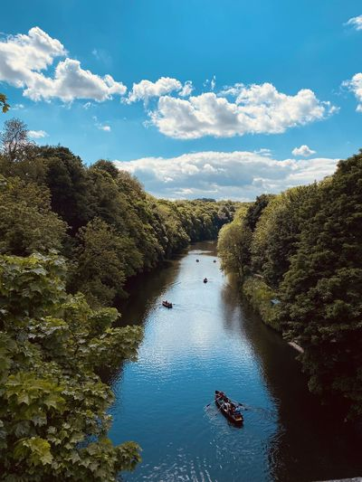 Durham city in june 2021. a high angle view of river amidst trees against sky. camera is iphone 11.