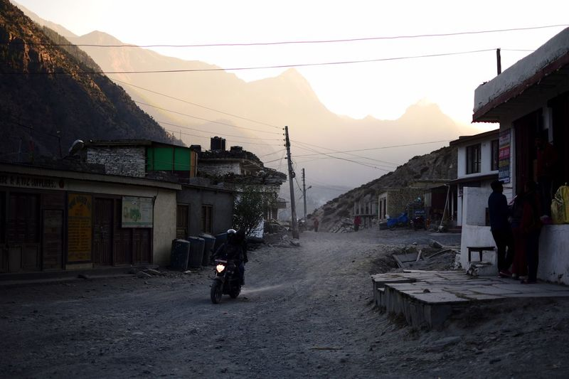 In the streets of lower Mustang. Motorcycle Mustang Himalayas Sunset Nepal Building Exterior Built Structure Architecture Sky Street Building City Transportation Nature Sunset Mountain Incidental People Real People The Way Forward Road Direction Mode Of Transportation Outdoors House It's About The Journey