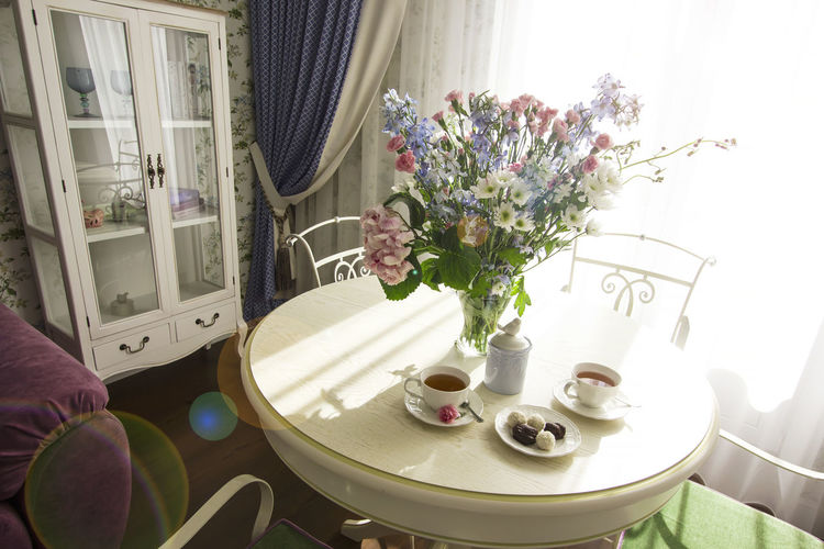 High angle view of flower vase on table at home