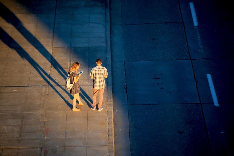 A couple wait