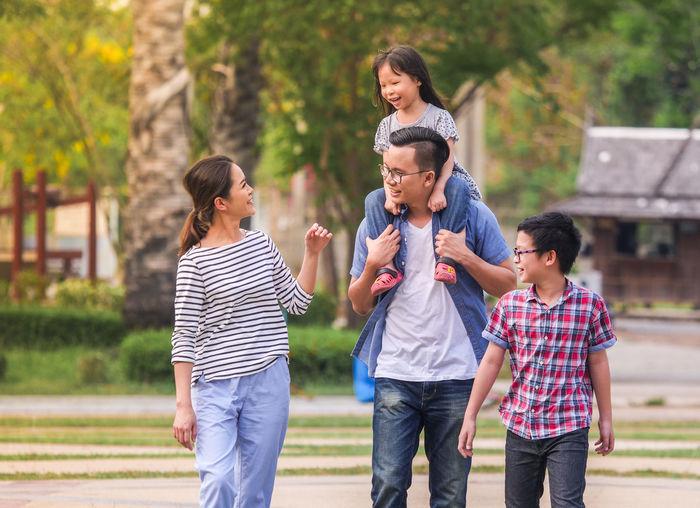 Happy family walking at park