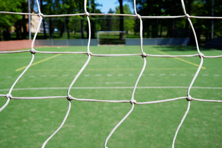 Close-up of net at soccer field