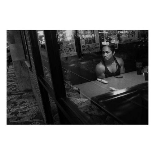 While she waits | Dinner with the missus | @abioj | Blackandwhite Bnw Monochrome Fujifilm x100s night | lasvegas olympiaweekend