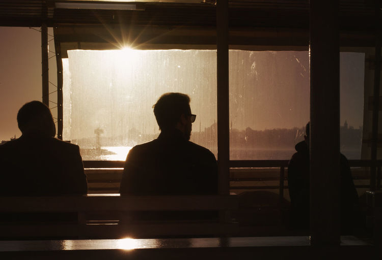 sunset in istanbul City Cityscape Istanbul Sunday Day Illuminated Indoors  Men People Real People Rear View Silhouette Sitting Sky Sunbathing Sunlight Sunset Two People Window Stories From The City Go Higher Focus On The Story The Traveler - 2018 EyeEm Awards Summer Road Tripping