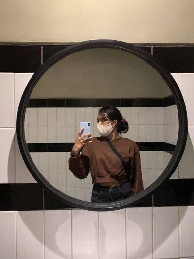 Mirror selfie at the toilet, also wear a mask