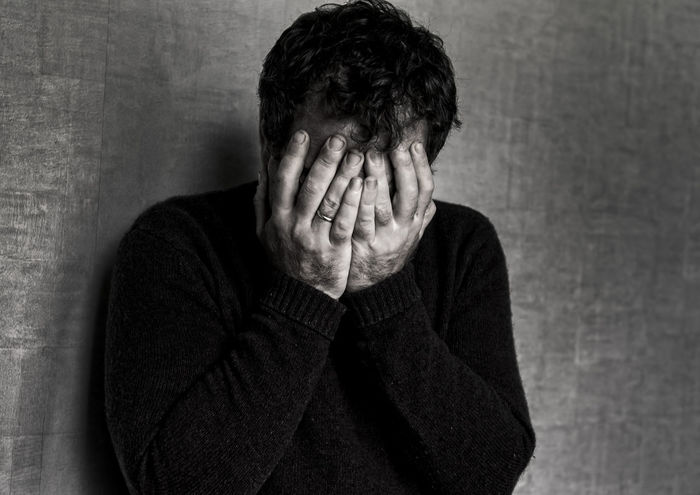 Adult Adults Only Casual Clothing Day Depression - Sadness Embarrassment Head In Hands Hiding Human Hand Indoors  Loneliness Men One Man Only One Person People Real People Relationship Difficulties Sadness Silence Young Adult
