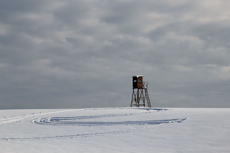 Hunting pulpit for Hunting in the Snow Cloud - Sky Sky Winter No People Nature Snow Cold Temperature Day Scenics - Nature Land Outdoors Beauty In Nature Tranquil Scene Observation Point Winter Wonderland Wintertime Hunting Hochsitz Hunting Pulpit Winter Landscape Winter_collection