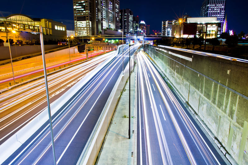 Illuminated Night City Long Exposure Motion Speed Light Trail Architecture Built Structure Transportation City Life Street Building Exterior Road Blurred Motion Traffic No People High Angle View Outdoors Highway Cityscape Track Office Building Exterior Skyscraper Tokyo Night