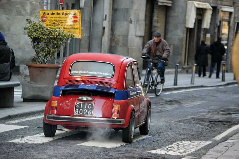 Small Car Italy Florence The Best City In The World Small Car colour of life Mode Of Transport Transportation Land Vehicle Street Car Speed Outdoors Adult One Person Day People City Real People Road Red Mobility In Mega Cities