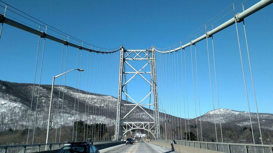 Suspension bridge against clear blue sky