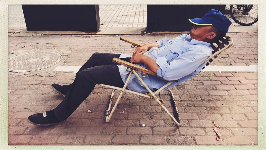Citylife Shanghai Streetphotography One Person Real People Auto Post Production Filter Sitting Full Length Transfer Print Relaxation Lifestyles Leisure Activity Casual Clothing Clothing Hat Men Outdoors Land Nature Males  Day Seat