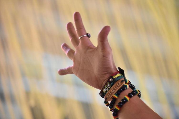 Close-up of bracelets on wrist