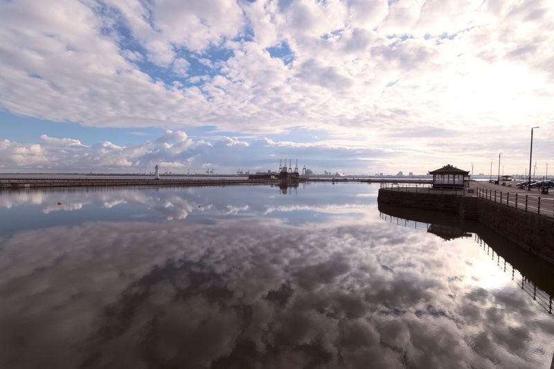 Reflection Of Clouds In Calm Sea