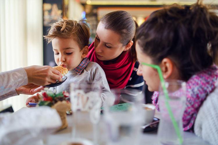 Family having food in restaurant