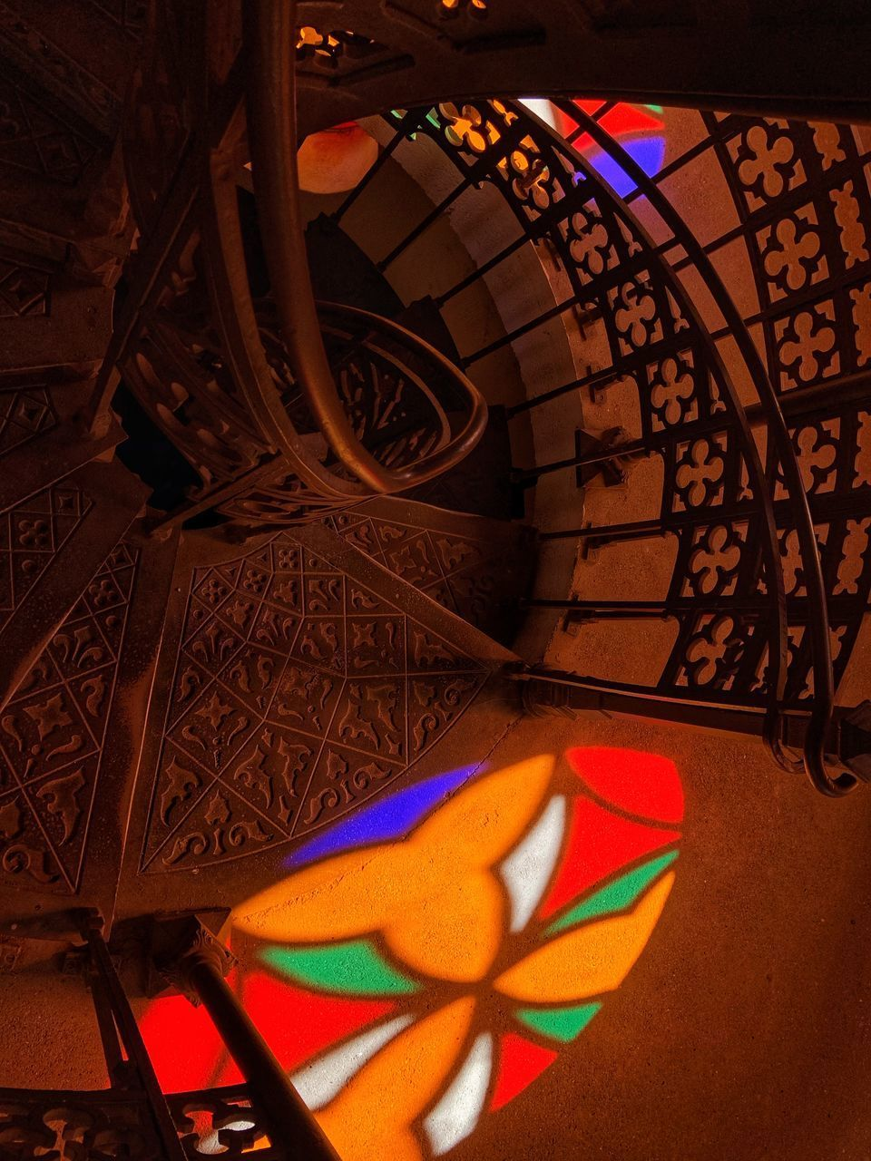 multi colored, architecture, art and craft, indoors, pattern, design, built structure, no people, creativity, staircase, close-up, spiral, craft, steps and staircases, railing, illuminated, metal, focus on foreground, high angle view, floral pattern, ornate