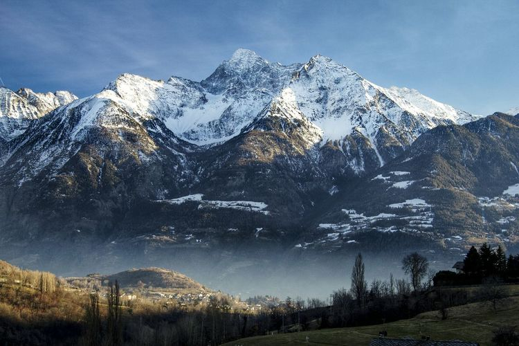 Scenic view of snowcapped mountains at aosta valley