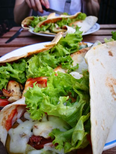 Close-up of wraps in plate on table