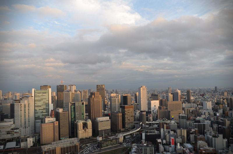 Osaka cityscape against cloudy sky