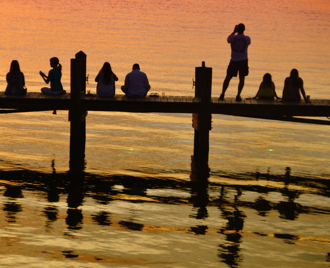 Water Group Of People Real People Sunset Men Sky Silhouette Reflection Lifestyles People Women Adult Nature Standing Leisure Activity Architecture Sea Waterfront Beauty In Nature Outdoors Looking At View Relaxing Pier