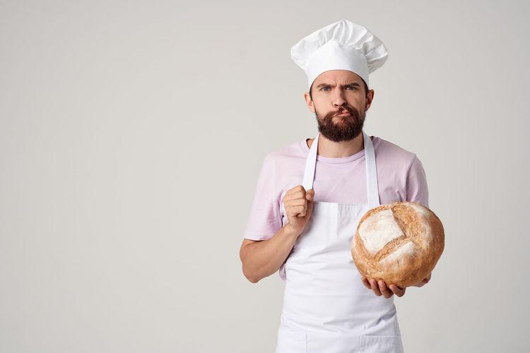 Man holding ice cream against white background