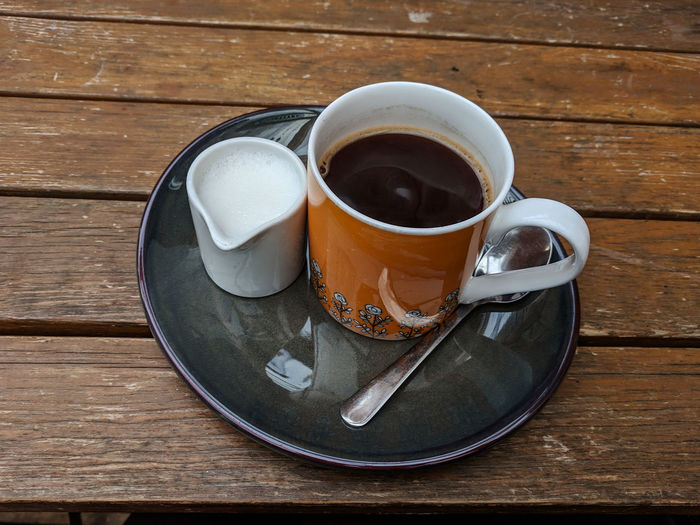 coffee and milk Cafe Cafe Time Black Coffee Milk Orange Color Shabby Wooden Wood - Material Rustic Drink Tea - Hot Drink Wood - Material Table Coffee - Drink Plate High Angle View Saucer Coffee Cup Close-up