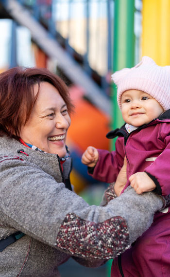 Portrait of happy mother and daughter in winter