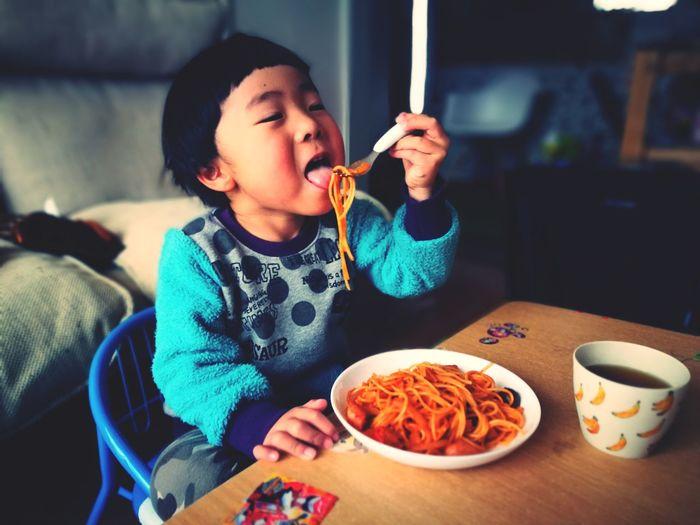 Close-up of cute baby boy eating food at home
