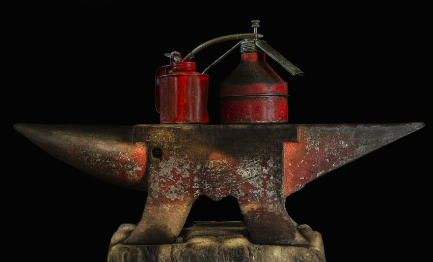 Close-up of fire hydrant against black background
