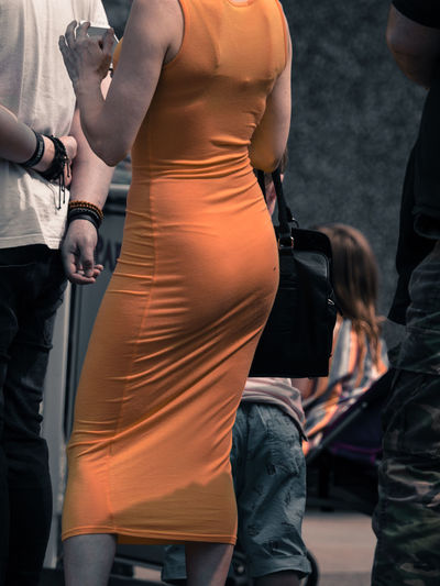 female body Adult Arts Culture And Entertainment Clothing Day Focus On Foreground Lifestyles Midsection Occupation Outdoors People Real People Rear View Standing Technology Togetherness Well-dressed Women The Street Photographer - 2018 EyeEm Awards