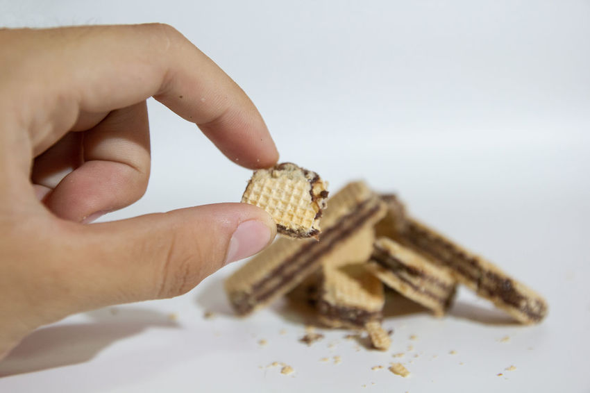 Wafer Bread Close-up Finger Focus On Foreground Food Hand Human Finger Human Hand Snack Studio Shot Wafer Waferchocolate White Background