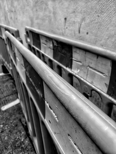 High angle view of railing by wall