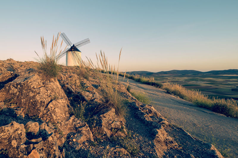 Quixote Windmill Alternative Energy Beauty In Nature Clear Sky Environment Environmental Conservation Fuel And Power Generation Landscape Nature No People Non-urban Scene Outdoors Plant Renewable Energy Road Scenics - Nature Sky Sustainable Resources Tranquil Scene Tranquility Turbine Wind Power Wind Turbine