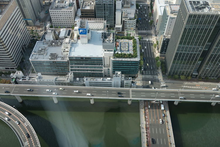 Aerial View Of Elevated Road Over River By Buildings In City