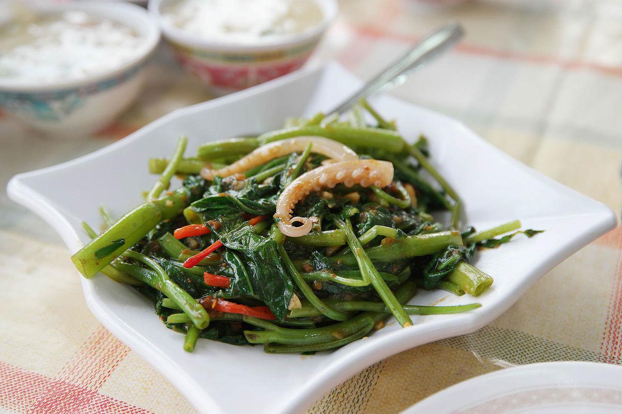 Sambal Kangkong Served In Plate On Table