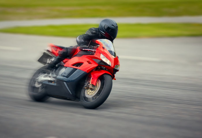 Fast motorbike racing on the race track at high speed. Competition Crash Helmet Day Driving Fast Motion Headwear Helmet Motorbike Motorcycle Motorcycle Racing Motorsport One Person Outdoors People Racecar Racedriver Speed Sport Sports Sports Clothing Sports Helmet Sports Photography Sports Race Sports Track Tire