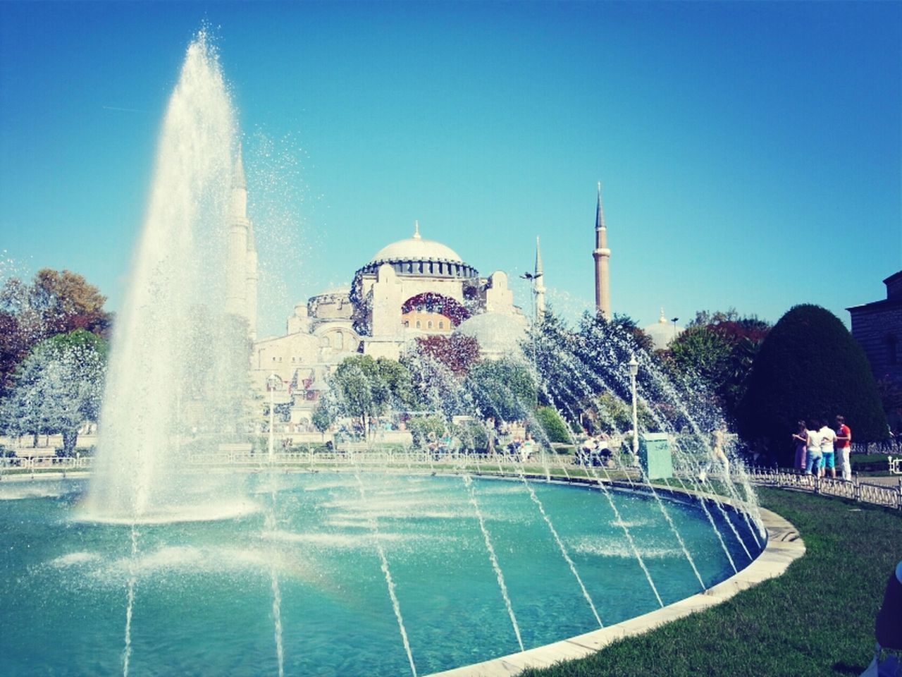 Fountain and mosque in background
