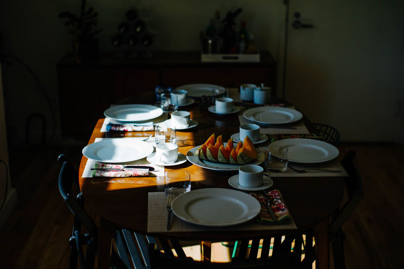 High angle view of plates arranged on table