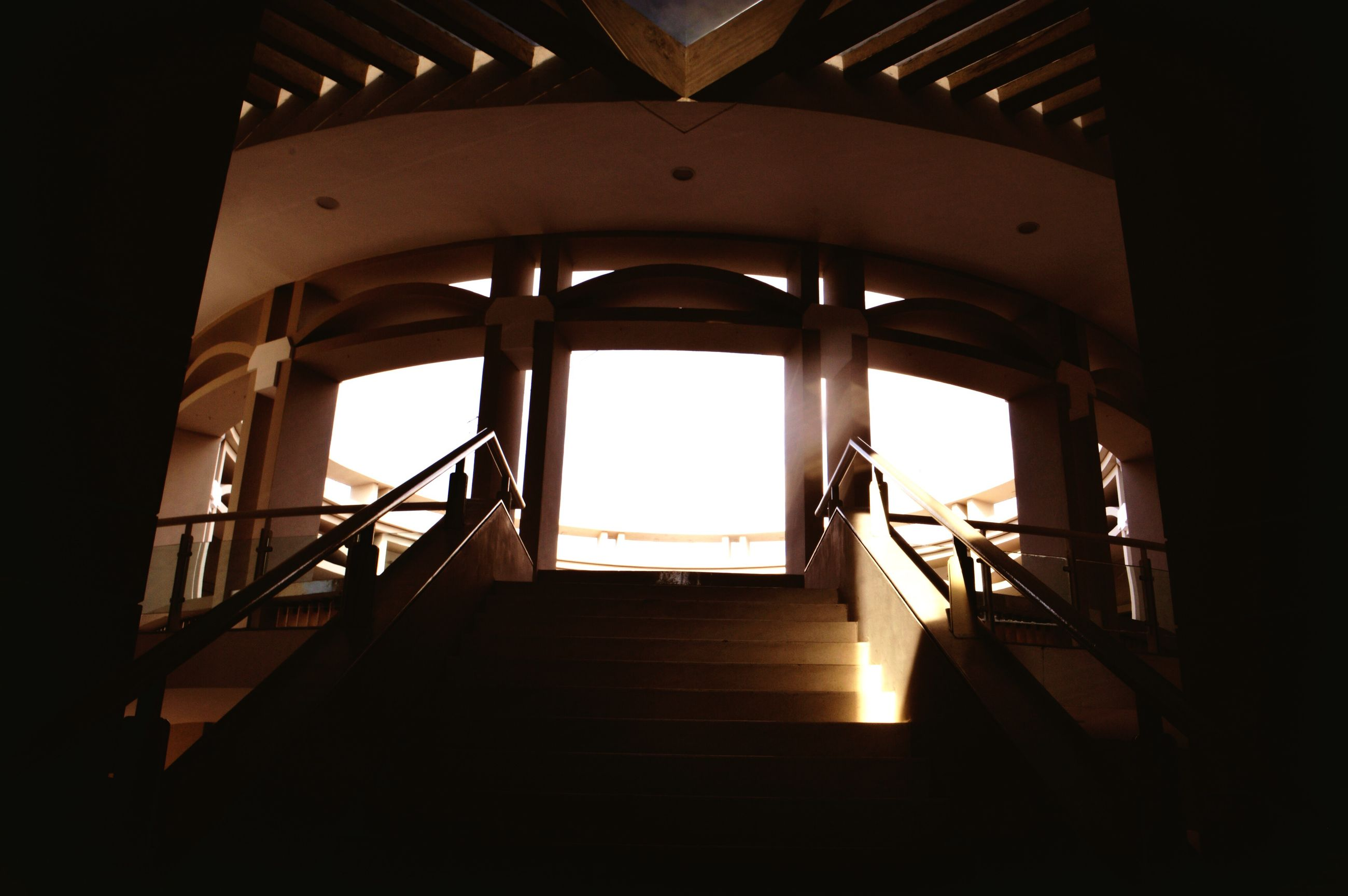 architecture, railing, built structure, indoors, staircase, steps, low angle view, sky, no people, day